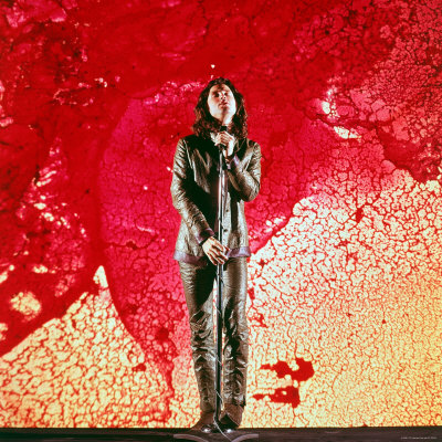 Rock Singer Jim Morrison of the Doors Posing in Front of Red and Yellow Psychedelic Backdrop